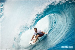 Pro surfer Dylan Longbottom surfing a sizable wave at Teahupo'o, Tahiti by Michael Clark.